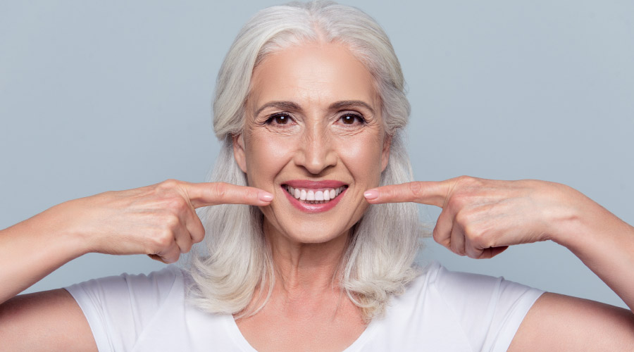 older woman with dental implants